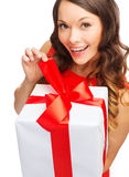 Smiling woman in red dress with gift box stock photography