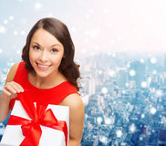 Smiling woman in red dress with gift boxes Royalty Free Stock Photos