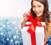 Smiling woman in red dress with gift boxes Royalty Free Stock Image