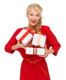 Smiling woman in red dress with many gift boxes Stock Image