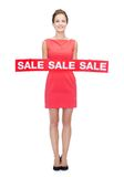 Smiling woman in red dress with sale sign Royalty Free Stock Image