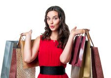 Smiling woman in red dress with shopping bags. Shopping, sale, gifts, christmas,  - smiling woman in red dress with shopping bags Royalty Free Stock Photo