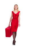 Smiling woman in red dress with suitcase isolated Royalty Free Stock Images