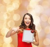 Smiling woman in red dress with tablet pc. Christmas, technology, present and people concept - smiling woman in red dress with blank tablet pc computer screen Stock Image