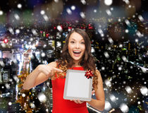 Smiling woman in red dress with tablet pc. Christmas, technology, present and people concept - smiling woman in red dress with blank tablet pc computer screen Stock Images