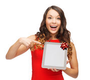 Smiling woman in red dress with tablet pc Stock Photo