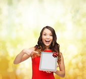 Smiling woman in red dress with tablet pc Stock Photos