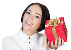 Smiling woman with the red gift box Royalty Free Stock Image