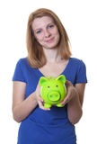 Smiling woman with red hair and piggy bank Stock Photo