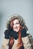Smiling Woman with Red Hair Wearing Winter Clothes Royalty Free Stock Photography