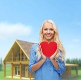 Smiling woman with red heart Stock Images