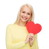 Smiling woman with red heart Royalty Free Stock Photography