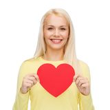 Smiling woman with red heart Royalty Free Stock Images