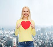 Smiling woman with red heart Stock Image
