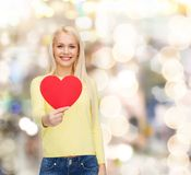Smiling woman with red heart Royalty Free Stock Image