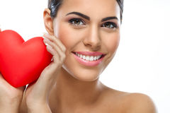 Smiling woman with red heart Royalty Free Stock Photo