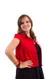 Smiling woman with red jacket. Hands on hips Royalty Free Stock Photo
