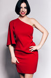 Smiling woman with red lips and dress Stock Image
