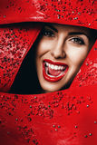 Smiling woman with red lips in frame Stock Image