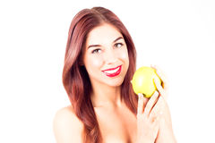 Smiling woman with red lips holding a green apple. Royalty Free Stock Photo