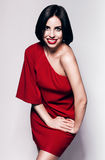 Smiling woman with red lips and red dress Stock Photography