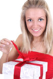 Smiling woman in red opening Royalty Free Stock Images