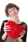 Smiling woman with red plush heart Royalty Free Stock Image