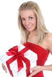 Smiling woman in red with present Stock Image
