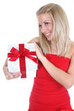 Smiling woman in red with present Stock Photos