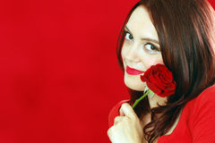 Smiling woman with red rose Royalty Free Stock Image