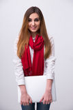 Smiling woman in red scarf with laptop Stock Image
