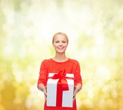 Smiling woman in red sweater with gift box Royalty Free Stock Photography