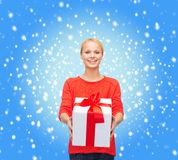 Smiling woman in red sweater with gift box Royalty Free Stock Image