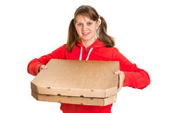 Smiling woman in red uniform delivering pizza in boxes Stock Image