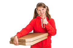 Smiling woman in red uniform delivering pizza in boxes Royalty Free Stock Photo