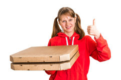 Smiling woman in red uniform delivering pizza in boxes Royalty Free Stock Photos