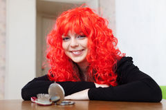 Smiling woman in red wig Stock Photos