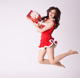 Smiling woman in red xmas sexy costume fly Stock Image