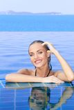 Smiling Woman Reflected In Pool Stock Photography