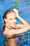 Smiling Woman Reflected In Pool Royalty Free Stock Photography