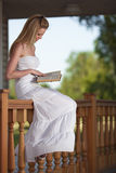 Smiling woman relax with book Stock Images