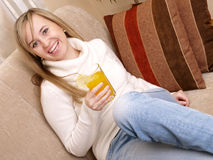 Smiling woman relax one the couch. Stock Images