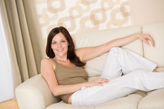 Smiling woman relax on sofa in lounge Stock Photography