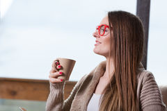 Smiling woman relaxing at home drinking coffee Stock Photos