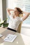 Smiling woman relaxing in office chair, relaxed at work, vertica. Positive smiling woman relaxing in office chair, happy businesswoman enjoys break, gets Stock Photos