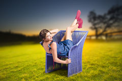 Smiling woman relaxing outdoors looking happy Stock Images