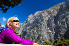 Smiling woman relaxing and resting in beautiful mountains Stock Photo