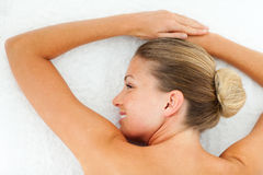 Smiling woman relaxing after spa treatment Stock Photo