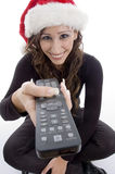 Smiling woman with remote control. Against white background Stock Photography