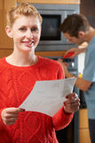 Smiling Woman With Repair Bill Stock Photos